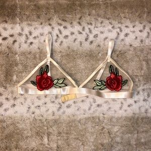 Sheer bralet with embroidered roses.
